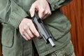 Soldier shutter cocking pistol gun Royalty Free Stock Photo