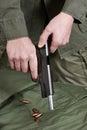 Soldier shutter cocking pistol gun Colt Royalty Free Stock Photo