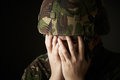 Soldier in uniform suffering from stress unhappy Royalty Free Stock Images