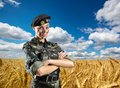 Soldier woman in military uniform ukrainian against wheat field Stock Images