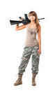 Soldier young beautiful girl dressed in a camouflage with a gun his hand on white background Royalty Free Stock Image