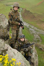 Soldiers in ammunitionon the cliff Stock Photography