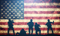 Soldiers in assault on USA flag. American army, military Royalty Free Stock Photo