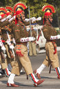 Soldiers marching in bright red and gold headdress parading down the raj path in preparation for the annual republic day parade in Royalty Free Stock Photo