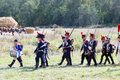 Soldiers marching with guns group of unknown a musician holding a drum is leading the group borodino battle historical reenactment Stock Photos