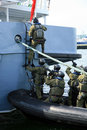 Soldiers marines ( sea commandos ) boarding a ship Royalty Free Stock Images