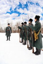 Soldiers in overcoats at historical reconstruction Stock Photo