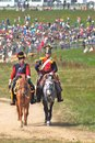Soldiers reenactors ride horses moscow region september two dressed as napoleonic war public tribunes are seen at Royalty Free Stock Photography