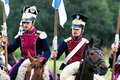 Soldiers ride brown horses borodino historical reenactment battle between russian and french armies taken on september in borodino Royalty Free Stock Images