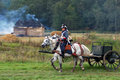 Soldiers ride white horses with a carriage borodino historical reenactment battle between russian and french armies taken on Stock Photography