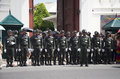 Soldiers stand in row at front of Wat Phra Kaew temple