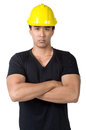 Solemn young foreman isolated yellow hard hat Royalty Free Stock Photography