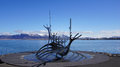 Solfar sun voyager sculpter in reykjavik iceland spring with mountains of snaefelsnes background Royalty Free Stock Photography