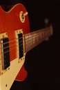 Solid body electric blues guitar closeup on black background. Selective focus. Royalty Free Stock Photo