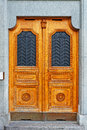 Solid door wooden in the swiss city Stock Photo