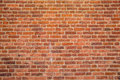 Solid rustic red bricks wall surface Royalty Free Stock Photo