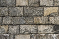 Solid stone block wall Stock Images
