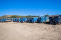 Solid waste bins truck portable blue for city town trash litter lined up outside durban site Stock Photography