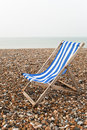 Solitary deckchair - Grey Day - vertical Royalty Free Stock Photos