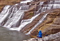 Solitary figure next to Ithaca Falls in rural New York Royalty Free Stock Photo