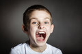 Solitary frightened boy screams in terror Royalty Free Stock Photo