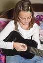 Solitary Girl with Guitar Royalty Free Stock Photo