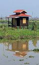 A solitary house on Inle Lake with yellow door Royalty Free Stock Photo