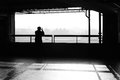 Solitary person black and white smoking in parking garage Stock Photography