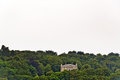 Solitude mansion standing on hill in forest. Erquy. Brittany. Royalty Free Stock Photo