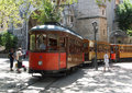 Soller tram to puerto de running through market square close to shoppers and tourists Stock Photography