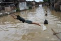 Solo flood a child swim when came in central java indonesia Stock Photography