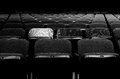 Solo seat image of a row of seats with a spotlight on one of them Stock Photos
