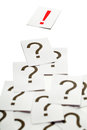 Solution concept - exclamation mark on top of question marks Royalty Free Stock Photo