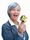 Solution - exited business woman holding a  cube Stock Photos