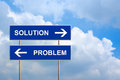 Solution and problem on blue road sign with sky Stock Photo