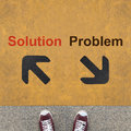 Solution and problem pair of shoes standing on a road with on yellow background Royalty Free Stock Images