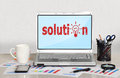 Solution symbol on screen laptop in office Royalty Free Stock Image