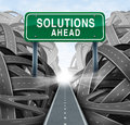 Solutions ahead and business answers concept with a green highway sign as an icon of breaking out from a confusion of tangled Stock Images