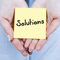 Solutions hands holding yellow paper Royalty Free Stock Photography