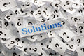 Solutions on question marks on white papers hard light Royalty Free Stock Photography