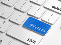 Solutions word on a keyboard in blue concept of business and services Royalty Free Stock Images