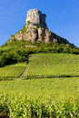 Solutre Rock with vineyards Stock Photos