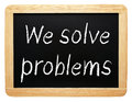 We solve problems written on slate sized blackboard or chalkboard white background business concept Royalty Free Stock Photo