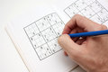 Solving a SUDOKU puzzle Royalty Free Stock Photo