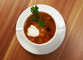 Solyanka on the plate russian soup with beef sausage chicken Royalty Free Stock Images