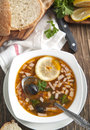 Solyanka, Russian soup with meat, sausage, olives and pickles Royalty Free Stock Photo