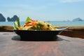 Som tam thai green papaya salad with an ocean background at tonsai beach Royalty Free Stock Photography