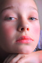 Somber young girl a closeup of a pretty little year old shallow depth of field Royalty Free Stock Photography