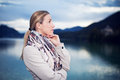 Sombre young woman standing thinking Royalty Free Stock Photo