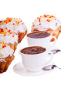 Some cakes and two cups of coffee on white isolated background Royalty Free Stock Image